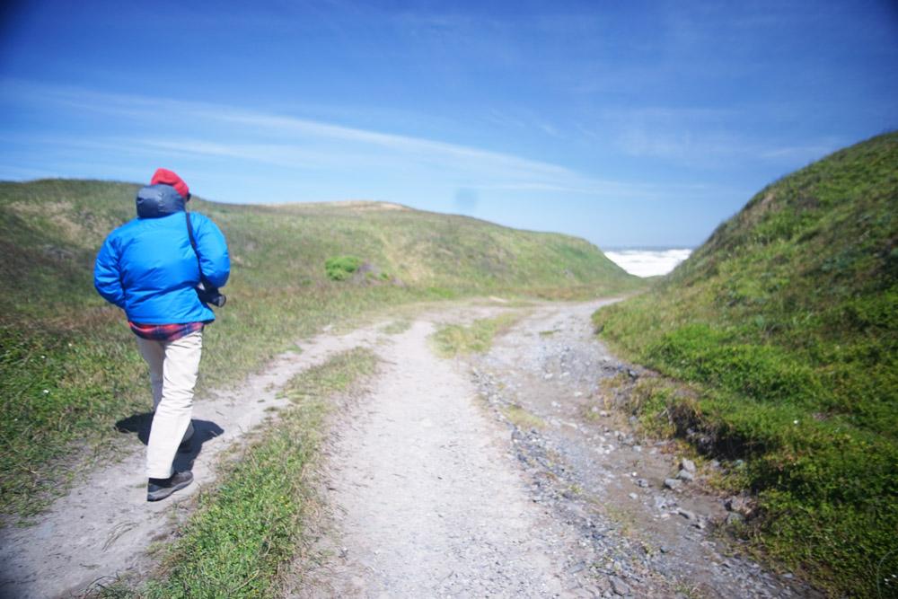 Dad walking towards the Pacific Ocean.