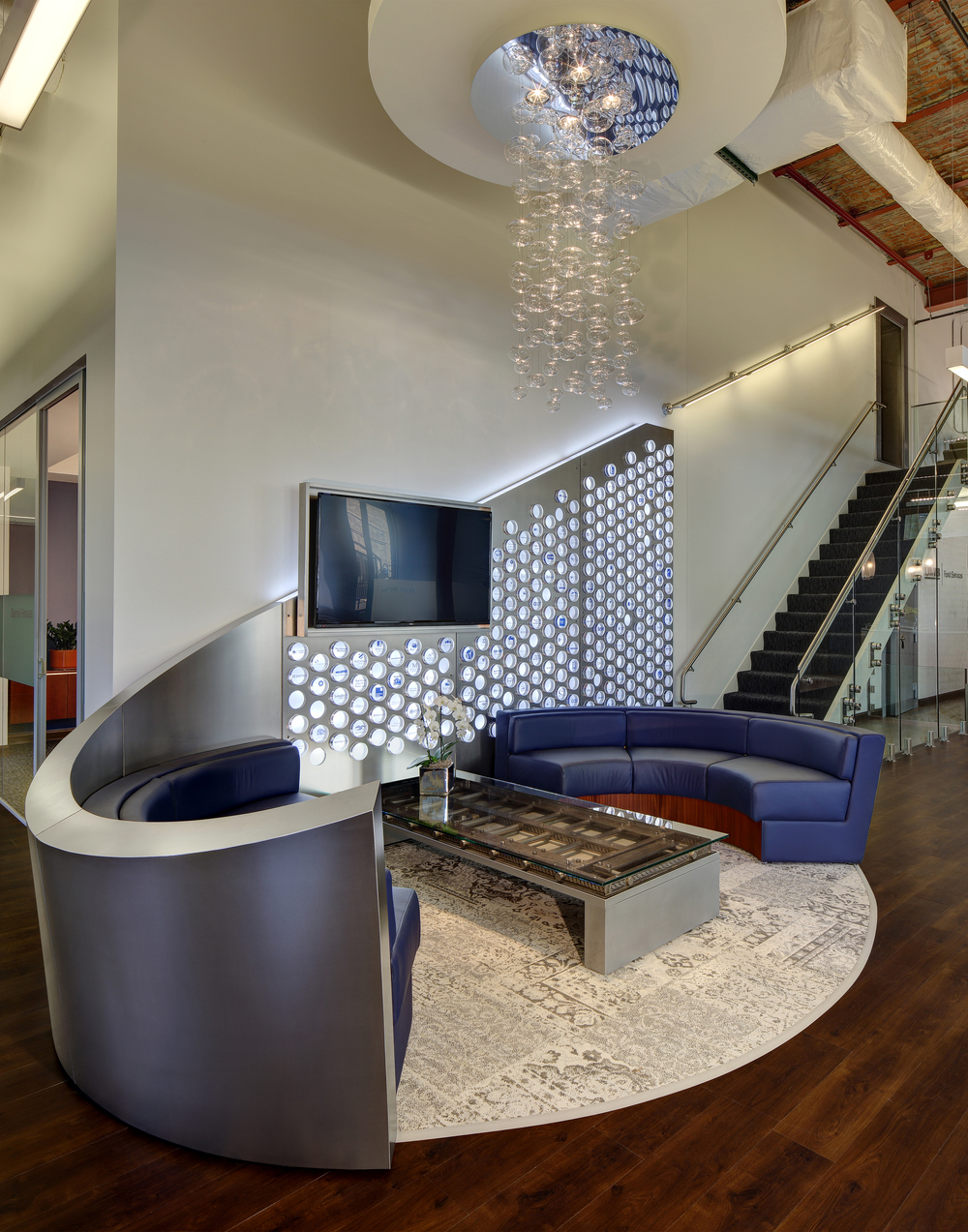 """UMB Fund Services Client """"Puck-Wall"""" & Custom Furniture (Sofas & Vault Door Coffee Table)"""