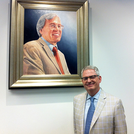 Vice Dean Charles G. Cannon with portrait
