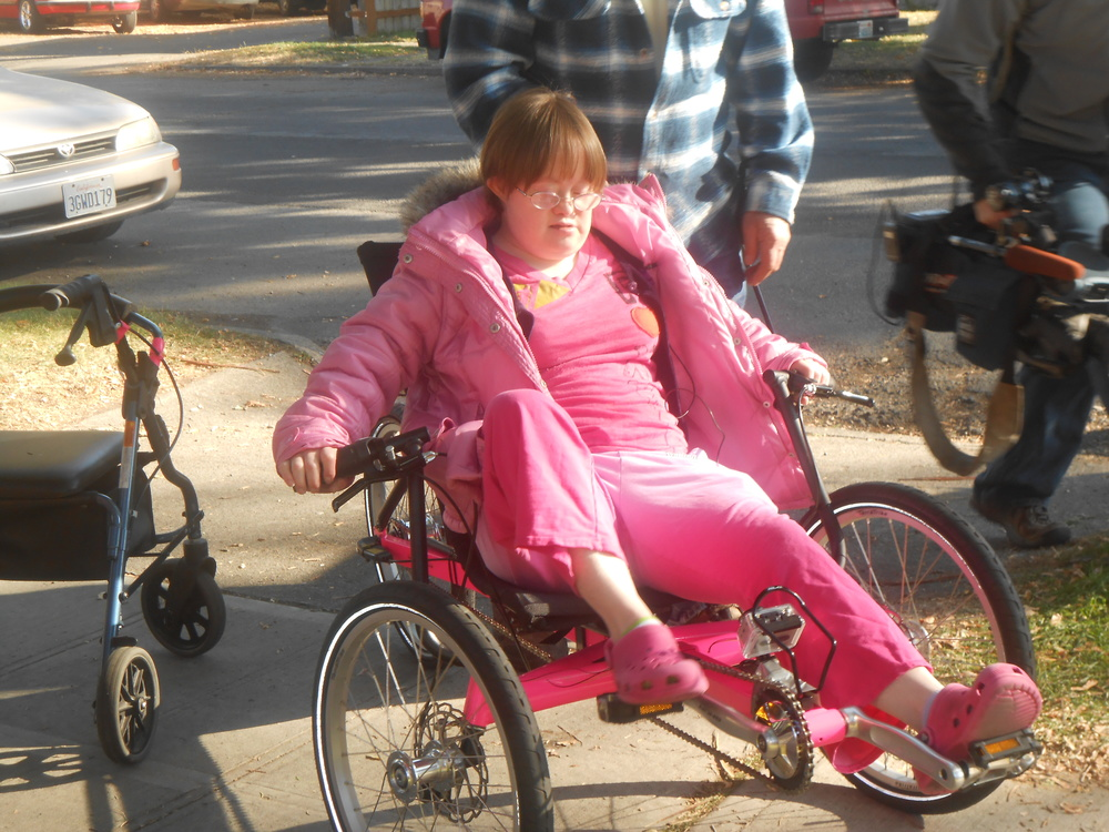 Jennifer riding her bike.JPG