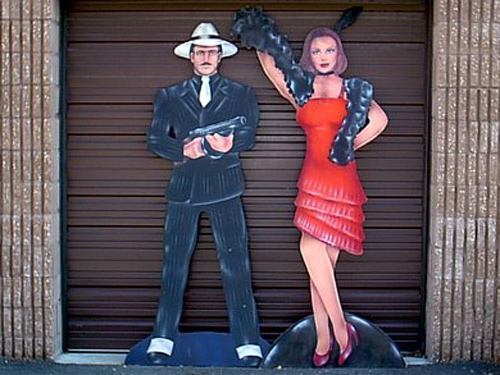 Gangsters- Make and Female, on heavy wood. About 7' tall.