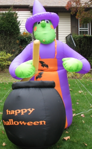 Large Inflated Witch about 8' tall.  Lights up at night.