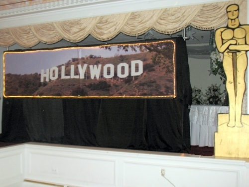 Hollywood Hills Banner:: self standing 8' tall and 12 feet wide. The sign measures 3' high and 12' wide. Surrounding the entire sign are rope lights.