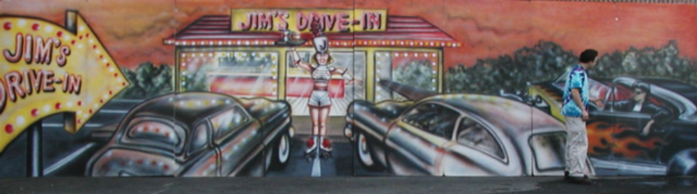 Jim's Drive In- Pull up your car, get your snacks and be served by the roller skating car hop girl. This foamcore piece measures 8'tall and 32' wide.