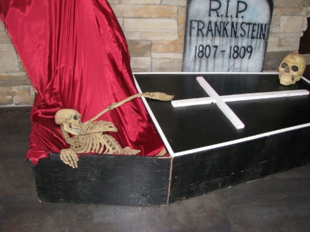 Prop Coffin:  Full sized with lid, skeleton, satin lined and red interior light