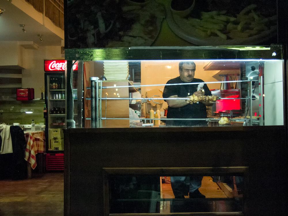 Man Tending Rotisserie