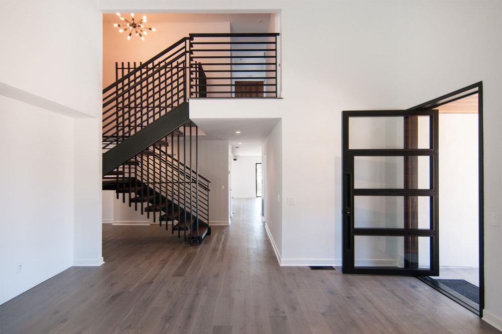 EOLUS   Pivot Door, Floating Tread Staircase, Railings & Custom Cabinets