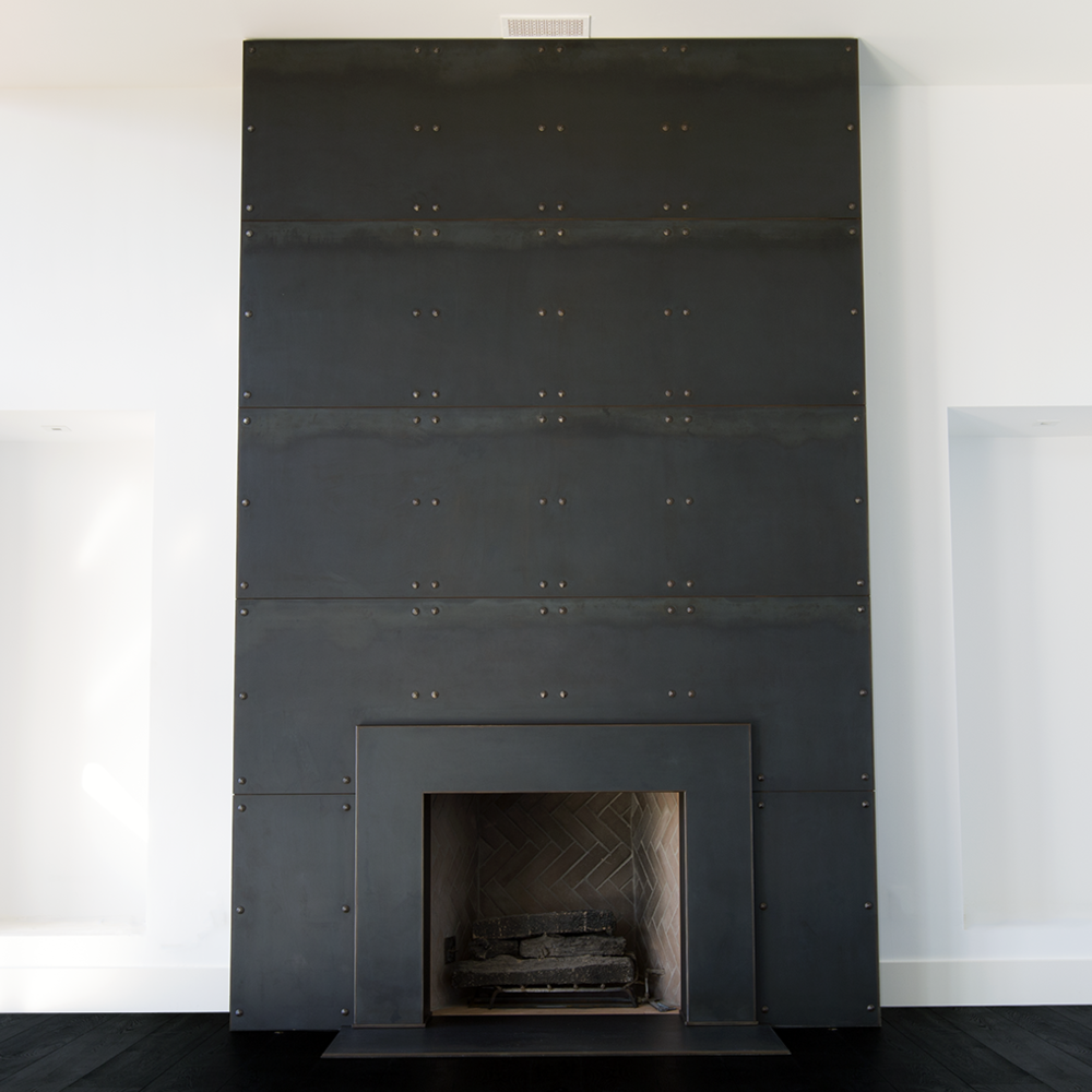 STARLIGHT   Steel Fireplace Wall With Custom Rivets And A Darkening Patina Finish