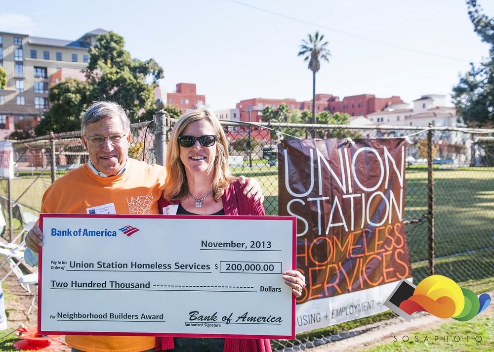 Marv Gross accepting the check from Bank of America on behalf of Union Station Homeless Services. Thanksgiving Goal met!