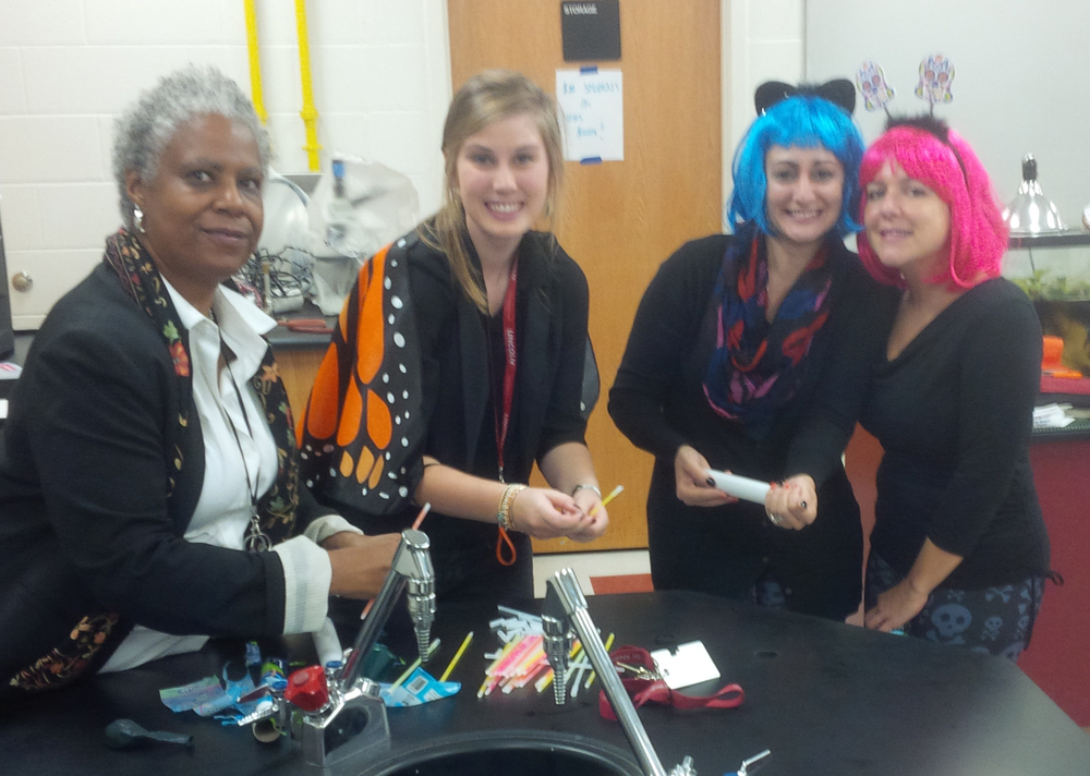 Principal Hawkins-Gladstone joins Grade Nine Team teachers Lindsay Cope, Bonnie Bucci and Rita Petricone, as they prepare for a scary but scientific Halloween Lab Demo by science teachers Jack Fair and David Evans (not pictured).