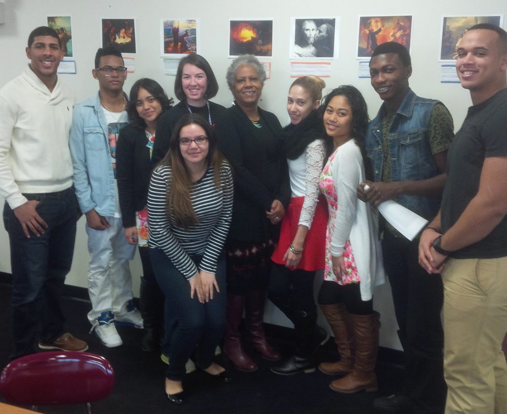 "Alvarez Principal Zawadi Hawkins-Gladstone stands with Teacher Leader Beth Northup and seniors participating in Northup's"" Allusion Studio"""
