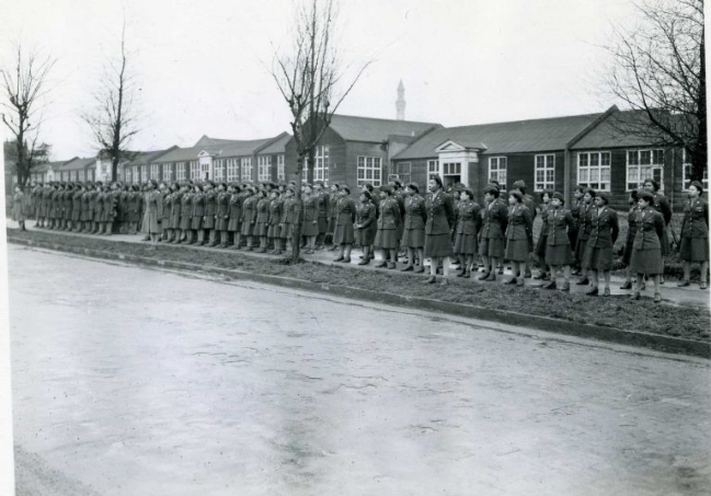 WACs who would later be organized into the 6888th Central Postal Directory Battalion stand in front of their quarters in England, 17 February 1945 (National Archives)