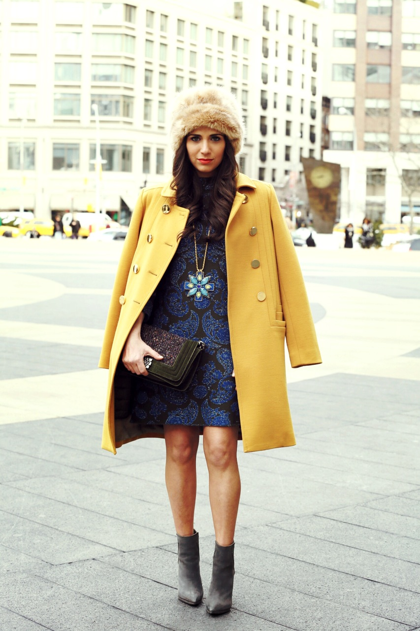 Photo Credit: PhotoDama  Hat: Ted Baker London, Coat: Orla Kiely, Necklace: Erickson Beamon, Dress: Issa London, Bootie: Steve Madden Bag: Chanel