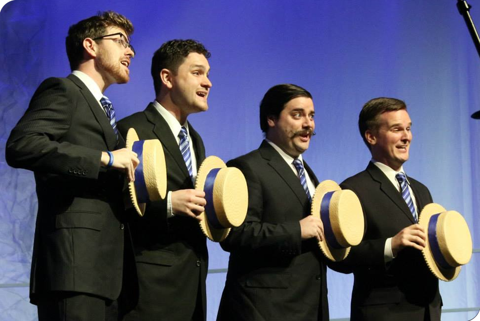 A Voices of Gotham breakout quartet during our performance at the 2013 Barbershop Harmony Society's International Chorus Contest, Toronto, ON 2013. L to R: Adam Bock – Tenor, Matt Saucier – Lead, Braden Lynk – Bass, Brian Lindvall – Baritone.