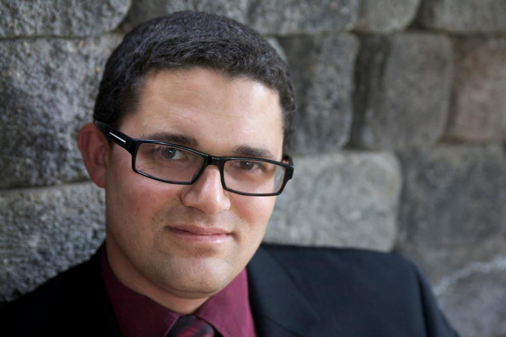 Voices of Gotham baritone Jude Thomas is a composer, performer, and freelance music writer.