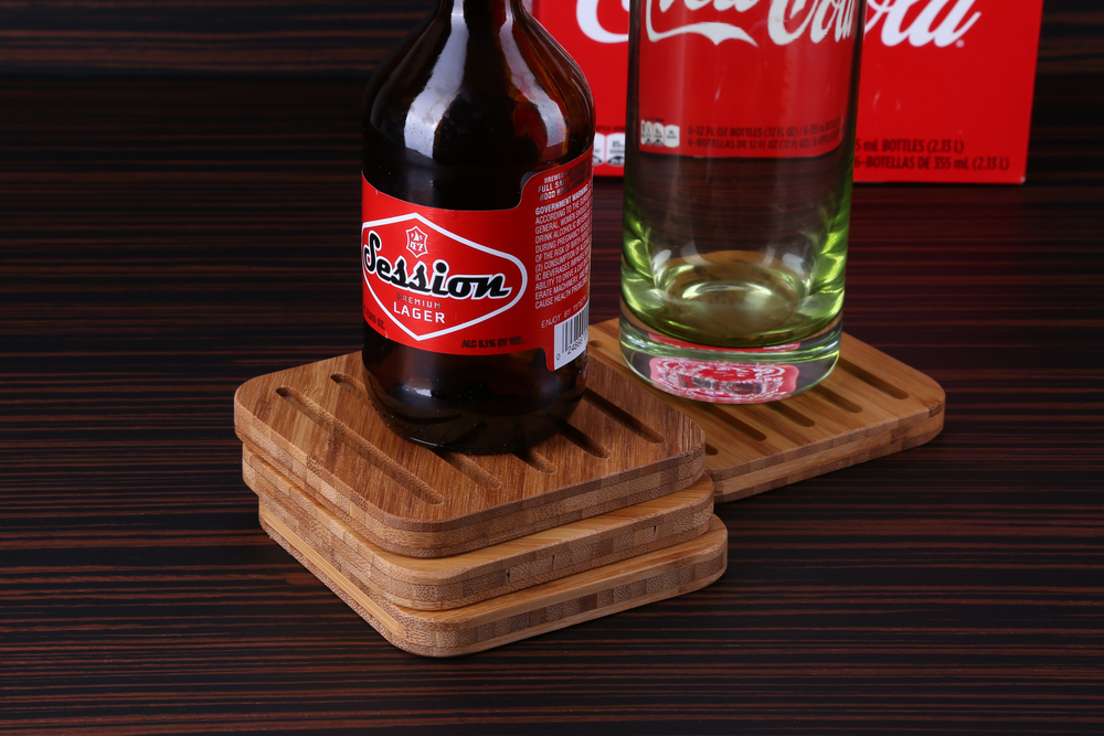 "Bamboo Coasters  The specially designed grooves in these coasters catch condensation and keep it from ruining your table top. Enjoy your favorite cold beverage worry free! These coasters are packaged in sets of four.  Approx. 4"" x 4"" Large size!"