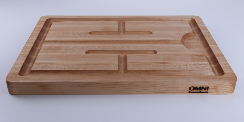 "Whether it's time for holiday feasting or even summer BBQ our Turkey Carving Board will get the job done. The extended juice groove pattern stabilizes your meat and collects all the juices. The addition of handles makes this board perfect for serving too.  Approx. measurements are 22"" x 16"" x 1.5"""
