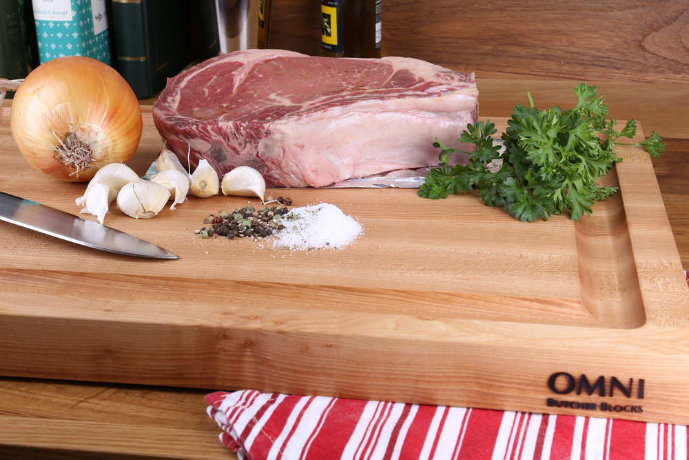 "This beautiful carving board is crafted out of hand-selected, Hard Sugar Maple. The extra large juice perimeter helps to catch juices from all your meats. This board is truly one of a kind!  Approximate measurements are 22"" x 16"" x1 1/2"". $145.00 plus applicable taxes and shipping."