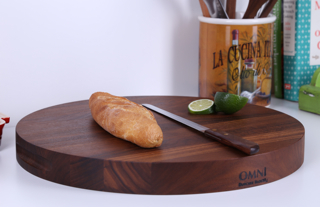"This elegant, round cutting board is made of American Black Walnut and doubles as an elegant serving platter. It comes with cut-out handles on the sides for easy lifting.  Approximate measurements are 17"" diameter x 1.5"" $129.00 plus applicable taxes and shipping."