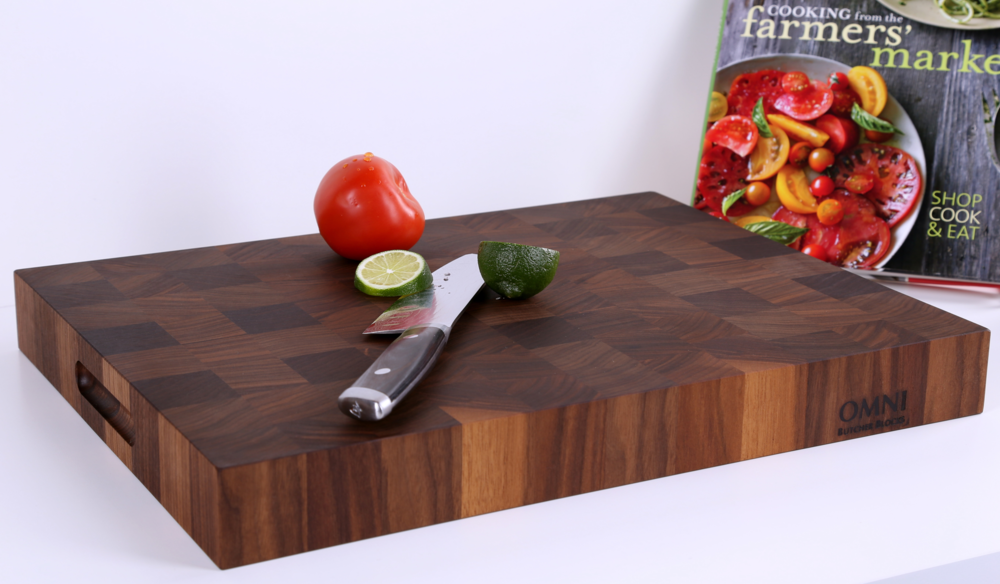 "Our best selling End Grain! Carefully handcrafted from specially selected, kiln-dried Black Walnut. This classic design is beautiful and durable and perfect for the home chef.  Approximate measurements are 18"" x 14""x 2"". $228.00 plus applicable taxes and shipping."