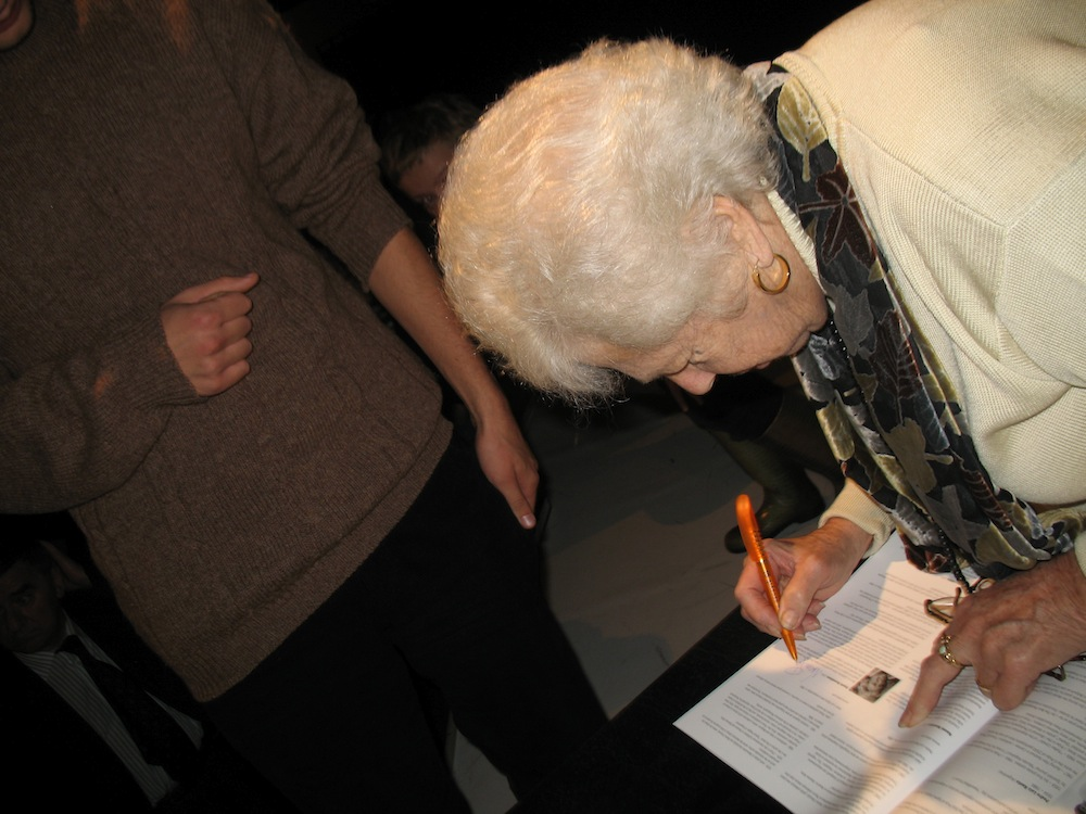 "Naomi Rosenblum autographing her book ""A World History of Photography"""