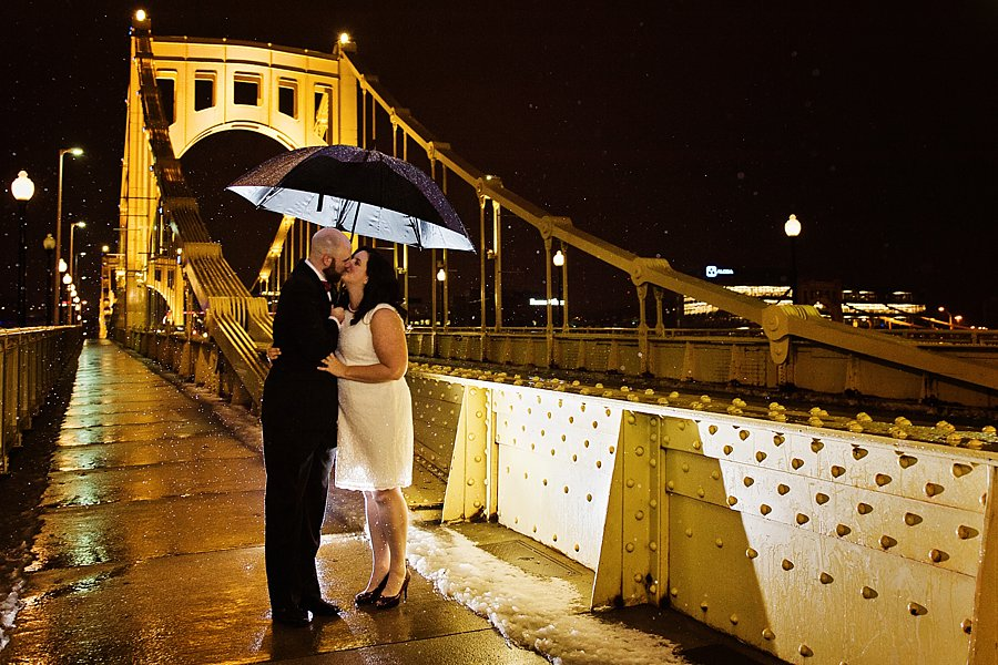 bride and groom on pittsburgh bridge