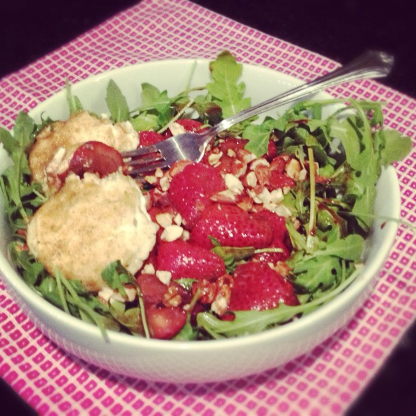 Warm strawberry and goat cheese salad with arugula, toasted almonds and homemade strawberry honey vinaigrette.