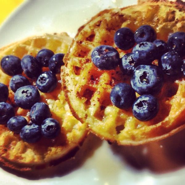 Gluten free waffles with blueberries and maple syrup