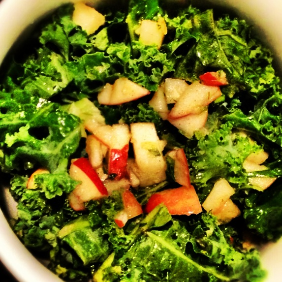 Healthy, fresh kale salad with apple, lemon and ginger