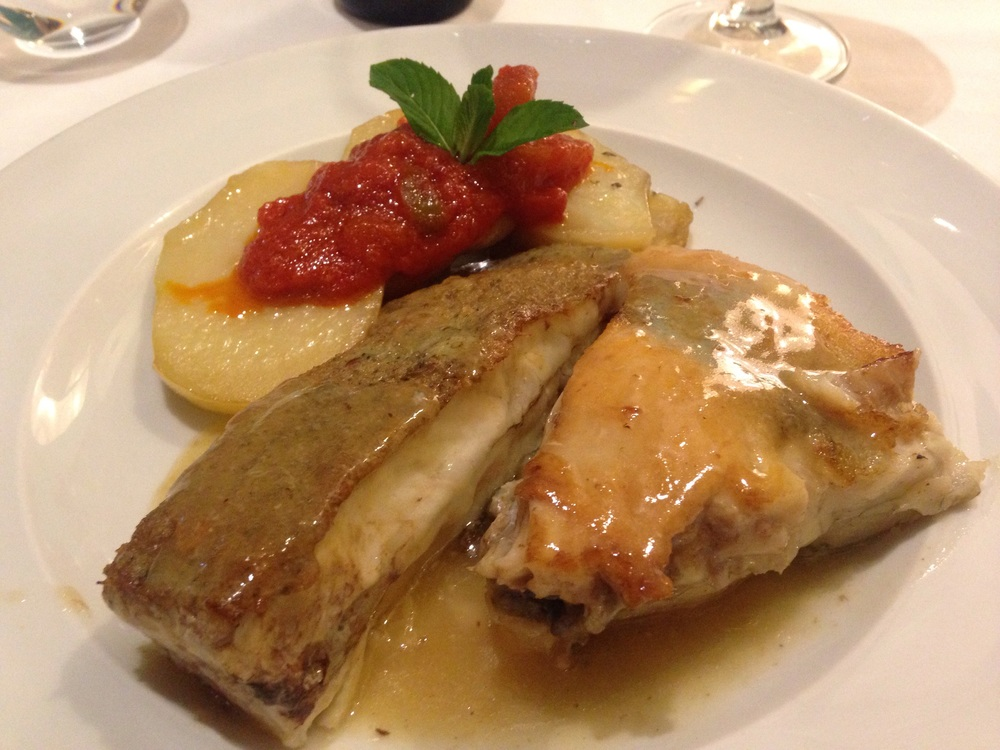 Turbot with lemon based sauce served with sautéed potatoes and pimentos.