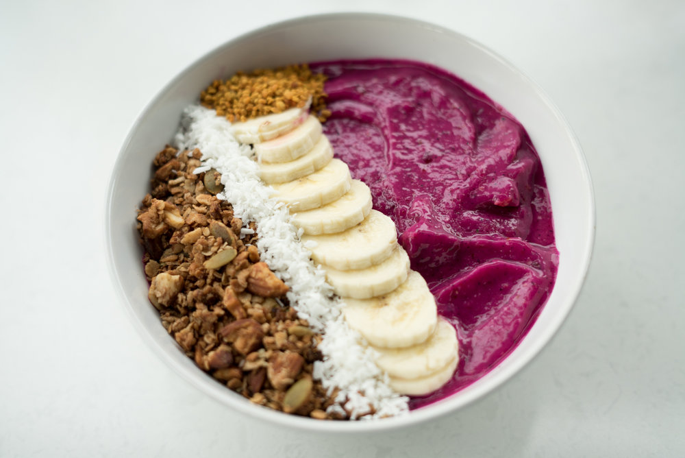 Smoothie Bowls - A delicious mixture of pitaya, mango and pineapple, topped with our house made granola!