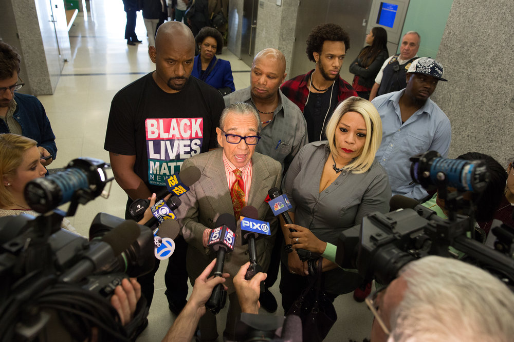 Attorney Sanford Rubenstein speaking to press at Kings County Supreme Court where New York City police officer Wayne Isaac faced charges after fatally shooting a man during an off-duty confrontation on July 4 in Brooklyn