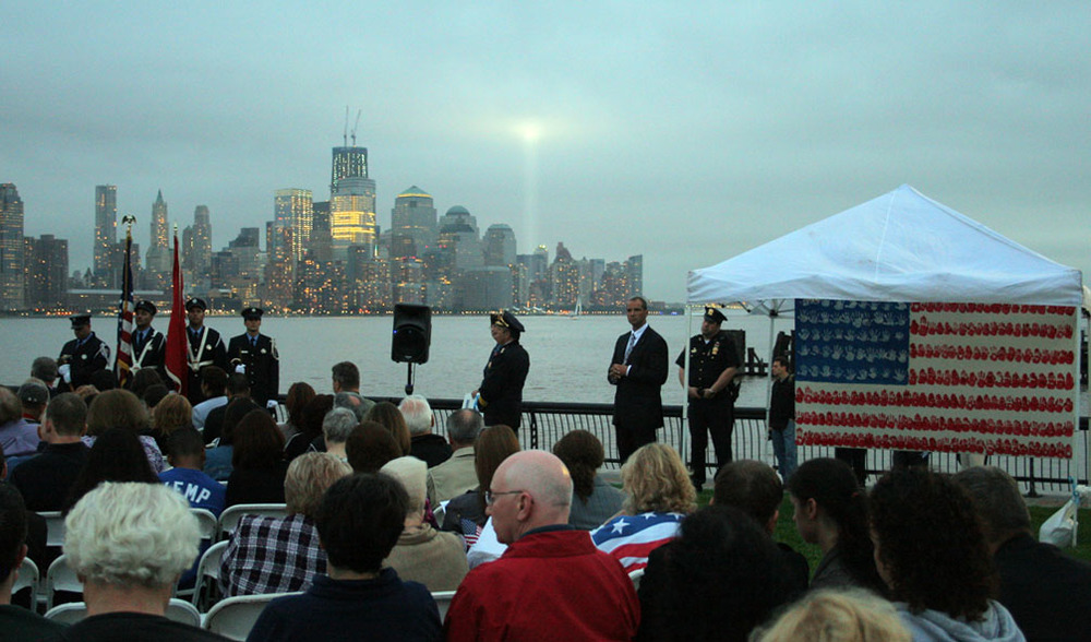 The flag on Pier A for the 10th anniversary with the Freedom Tower under construction, and the annual 'Tribute In Light'.