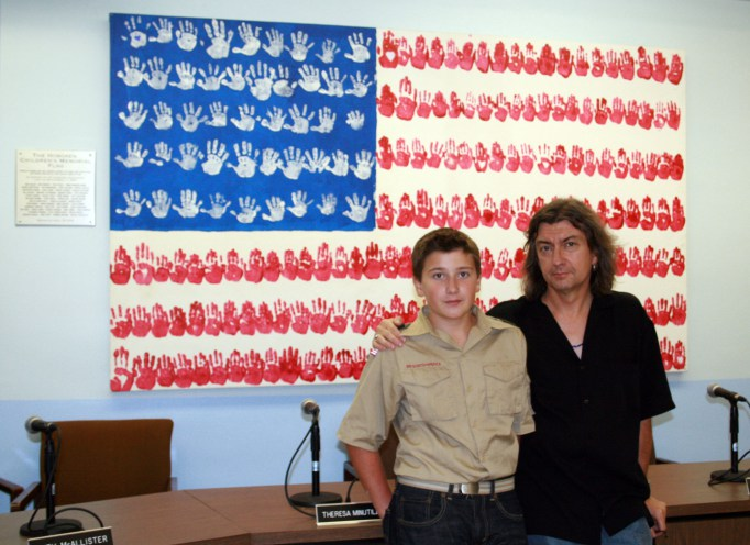 My son Charlie and I with the Hoboken Children's Memorial Flag at the Hoboken Board of Education meeting room.