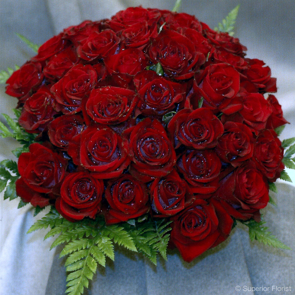 Superior Florist – Weddings – Personal Flowers: Bridal bouquet of red passion roses.