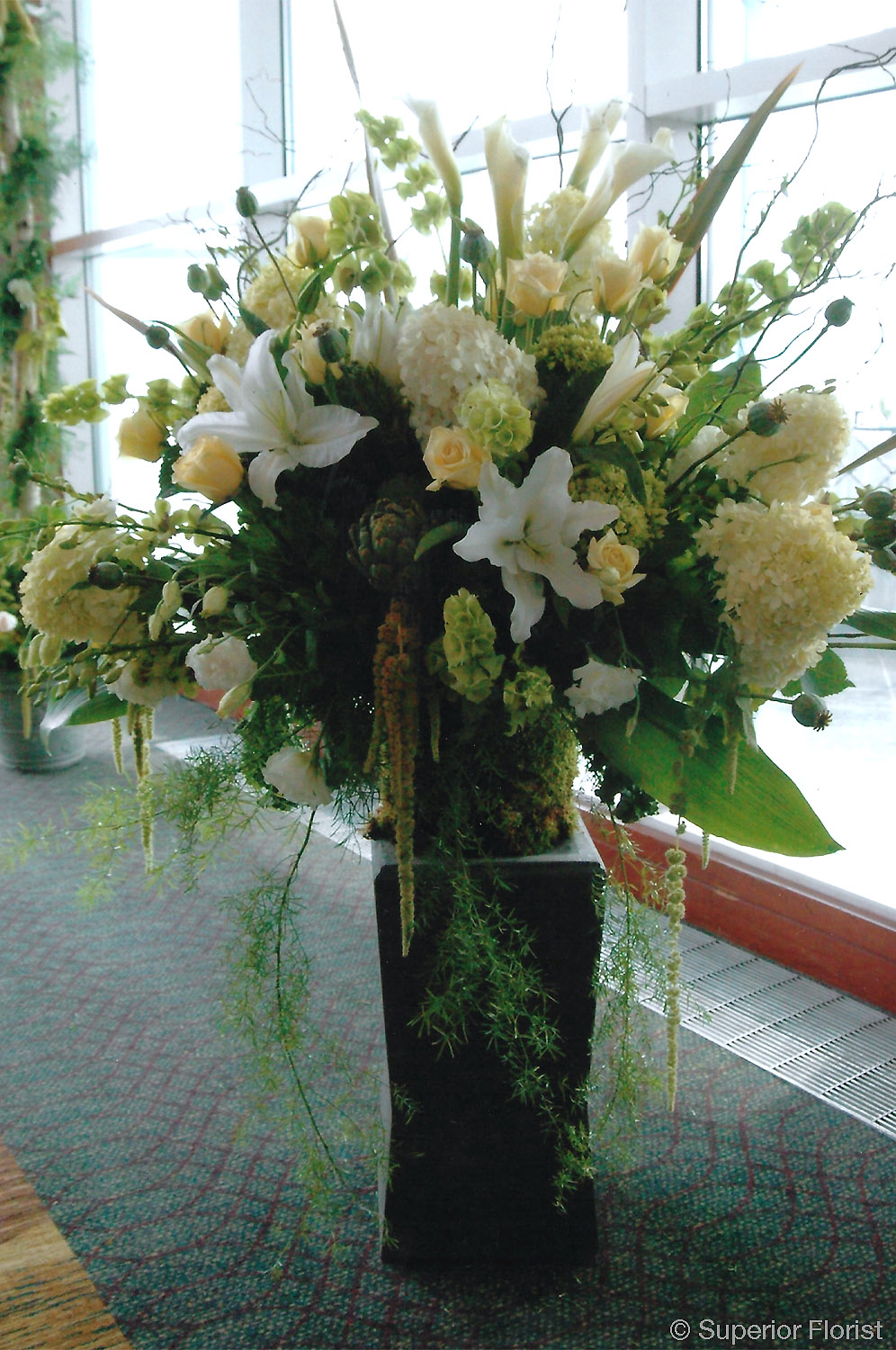 Superior Florist – Wedding Ceremony: Freestanding floral basket for wedding ceremony.