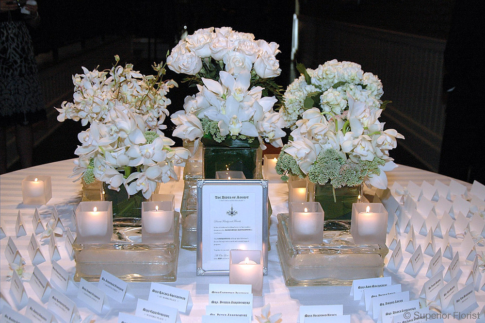 Superior Florist – Weddings – Escort Tables: White flowers, roses, orchids and Hydrangeas in a series of cube vases. The Lighthouse, Chelsea Piers, NYC.