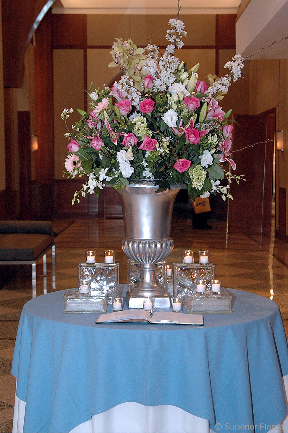 Superior Florist – Weddings – Escort Tables: Beautiful floral arrangement of whites, pinks and greens in a silver urn. Pier 60 at Chelsea Piers, NYC.
