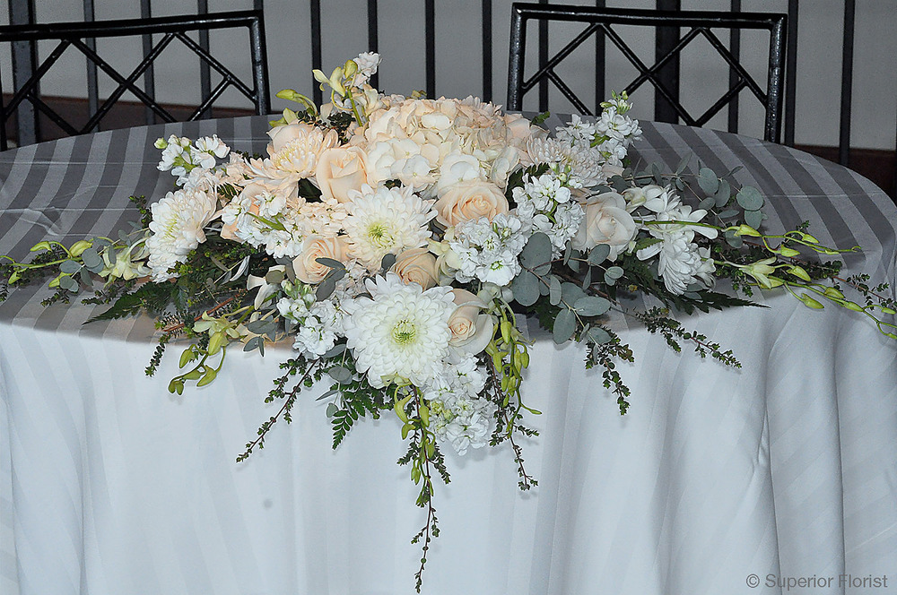 Superior Florist – Sweetheart Tables: Beautiful assortment of white and ivory flowers.