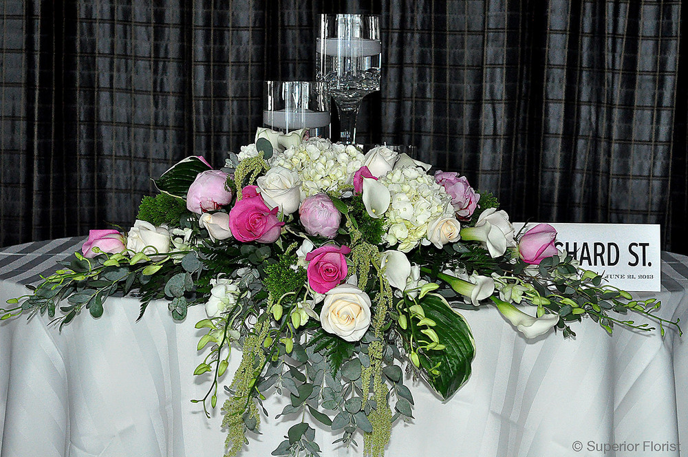 Superior Florist – Sweetheart Tables: Gorgeous assortment of pink and white flowers with foliage.