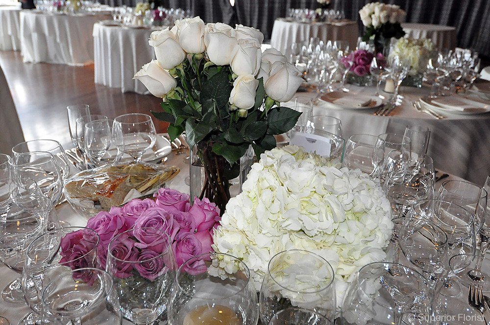 Superior Florist – Centerpieces:  Grouping of three floral arrangements of roses and Hydrangeas.