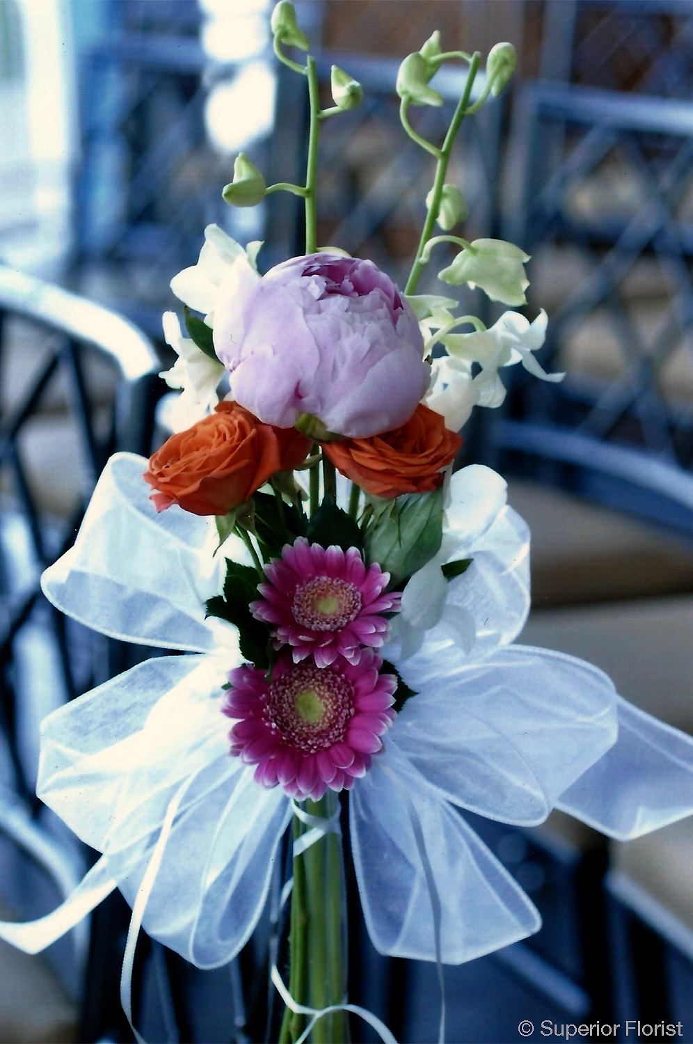 Superior Florist – Wedding Décor:  Chair bouquet of flowers with organza ribbon.