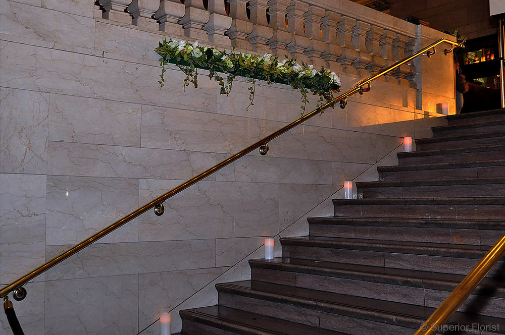 Superior Florist – Wedding Décor:  Candle accents on staircase and floral decoration on ledge at Grand Central Terminal, NYC.