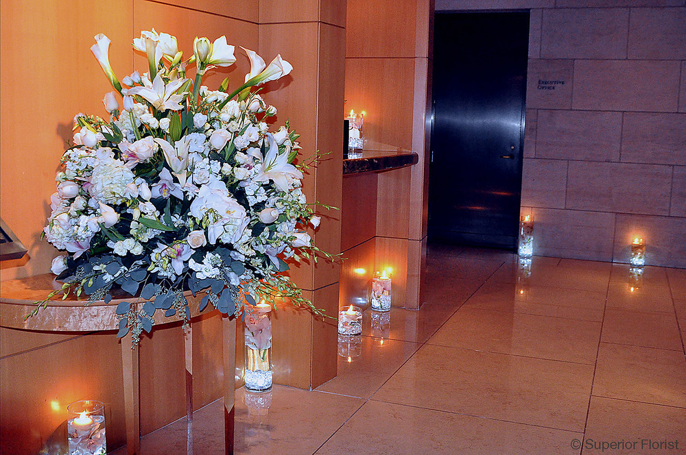 Superior Florist – Wedding Décor:  Floral and candle decorations. The Four Seasons Hotel, NYC.