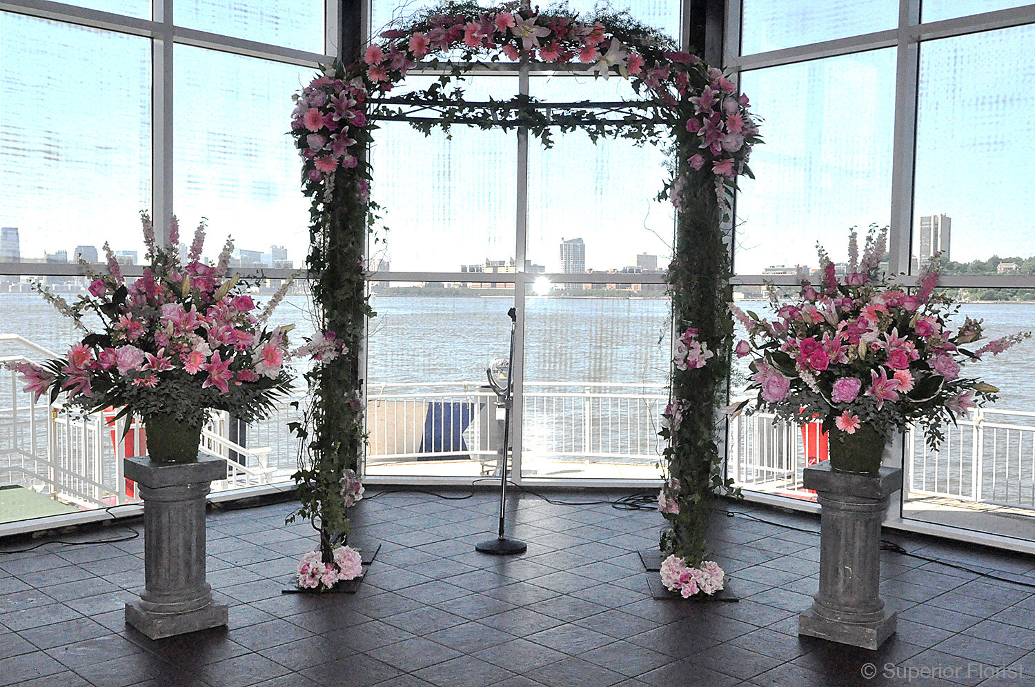 Superior florist event florals superior florist wedding ceremony bridal arch with crescent frame attached at top flanked junglespirit Image collections