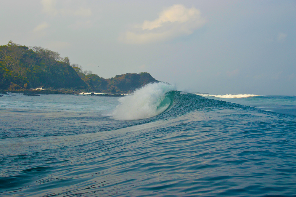 An unridden left peels off a secret reef.