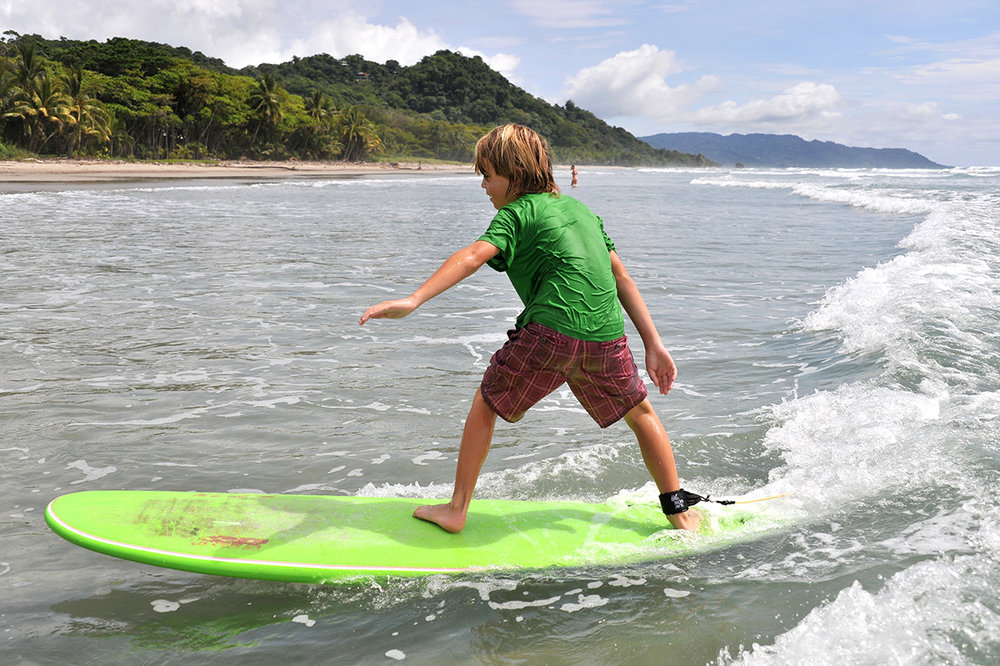 Take your kids on a private surf lesson... we know the perfect spots, they won't forget it.