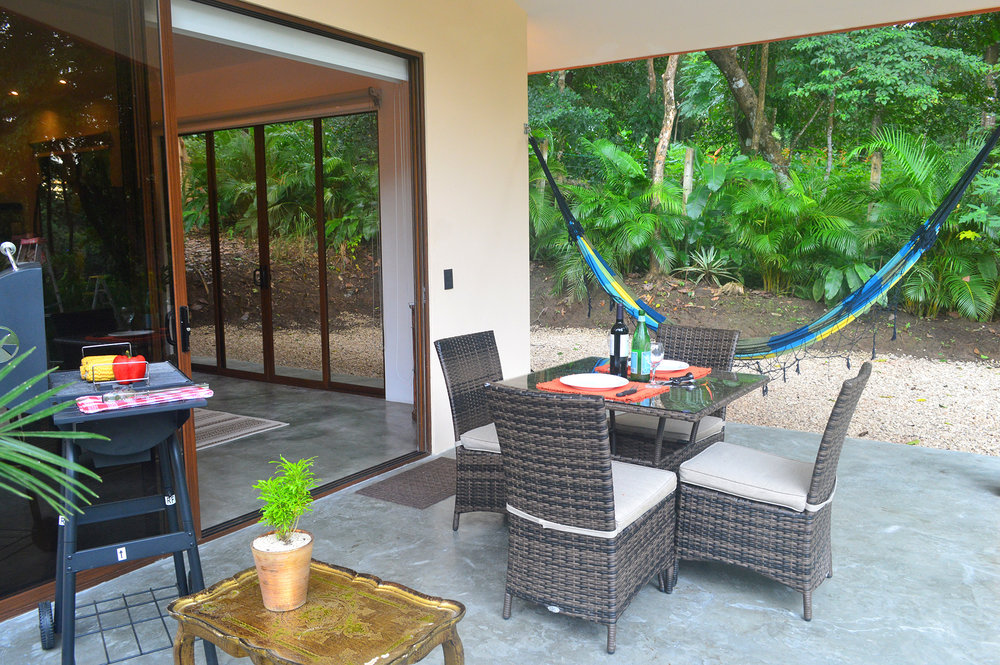 tropical-terrace-dining-area-cabin-rental-malpais.jpg