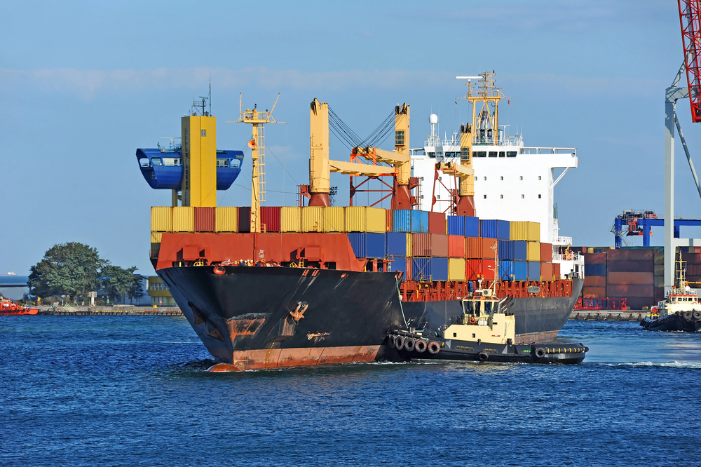 bigstock-Tugboat-assisting-container-ca-51503845.jpg