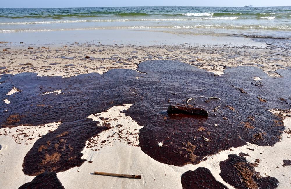 bigstock-Oil-Spill-On-Beach-8007350.jpg